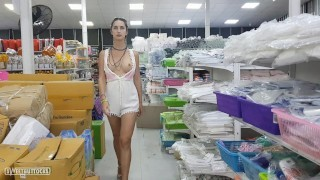 She shows her boobs and pussy right in the store